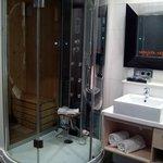 Sauna y ducha hidromasaje