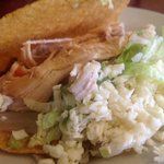 Chicken taco bursting with lettuce, cheese & onion