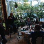 Hosts enjoying guests during breakfast