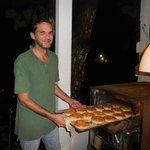 Jaime Escobar (owner) making his own hamburger bread