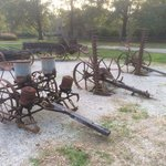 Antique farm equipment at entrance