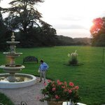 The back lawn of the chateau at sunset