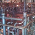 """more """"Dining""""  in the boiler room, all of the decor is pipe fuittings."""