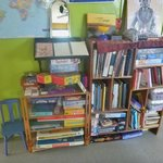 Bookshelf and games in the common lounge area