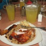 Jerk Chicken and Rice Dish and Pineapple Water Drink
