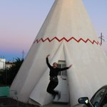 Jumping for joy in front of our wigwam.