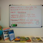 white board for guests with tourism pamphlets