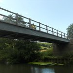 Cyclists bridge over the river Stour