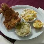 Two pork chop plate, macaroni and cheese, cabbage and corn muffin