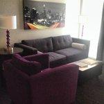 Sofa, chair, floor to ceiling window!