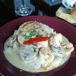 Garlic chicken and shrimp in a cream sauce with garlic mashed potatoes
