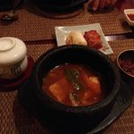 spicy soup and kimchi in hand crafted bowls