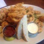 Shrimp platter! Delish! Fried shrimp, hush puppies, onion rings, fries and bread.
