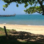 The beach and jetty directly across the road from Palm Cove Holiday Park