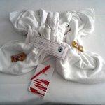 Cisne con tarjeta de bienvenida y dos galletas dulces