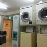 Coin operated laundry facilities beside lobby