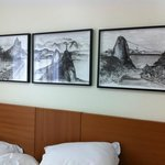 View of the room with nice drawings on the wall