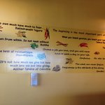Wall of great quotes from some of the most famous names in history adorns the wall at Curry Out.