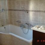 Bathroom en suite with shower over bath