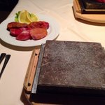 A mix plate of meat, with hot-stone for self service cook.
