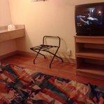clean bed.. floors... working tv