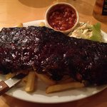 Rack of ribs with chips, coleslaw and spicy beans