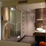The sliding door door reveals the shower