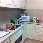 Kitchen with online ordered groceries from Coles