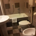 Complete bathroom with bidet.