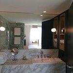 Bathroom with bathtub and walk-in shower