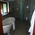 The spacious bathroom with tub & rain shower.