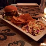 Burger with house-made chips and slaw.
