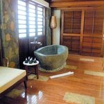 Bathroom of beachfront suite with door to private pool