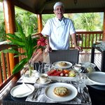 Errol the owner of Daintree Manor serves breakfast.