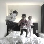 children having fun in hotelroom