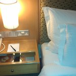 table with power outlets close to bed