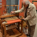 Our tour guide demonstrating how this older style loom works