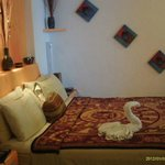 King bed with pretty swan.