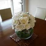 beautiful vases of flowers through out cottage
