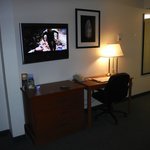 Television set and desk in the room.