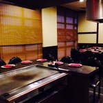 Several hibachi grill stations with lots of seating