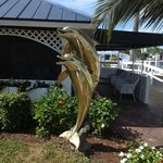 Brass dolphins outside Gramma Dot's