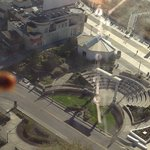 Lady bug scaling along 32nd floor window