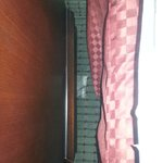Floor between end table and bed; Duct tape on floor
