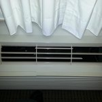 Heating / Cooling unit in room; Lots of broken slats
