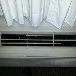 Heating / Cooling unit in room; Lots of broken slats
