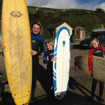 Saunton Sands - surfing with the kids -One happy Daddy!