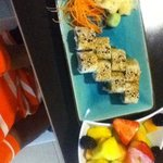 Kids sushi rolls made w cooked chicken, side of fruit salad-- at Waves restaurant.