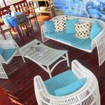 Our lounge and dining areas overlook the beautiful Caribbean Sea.