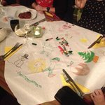 drawings on tablecloths with crayons to entertain us whilst waiting for food :)